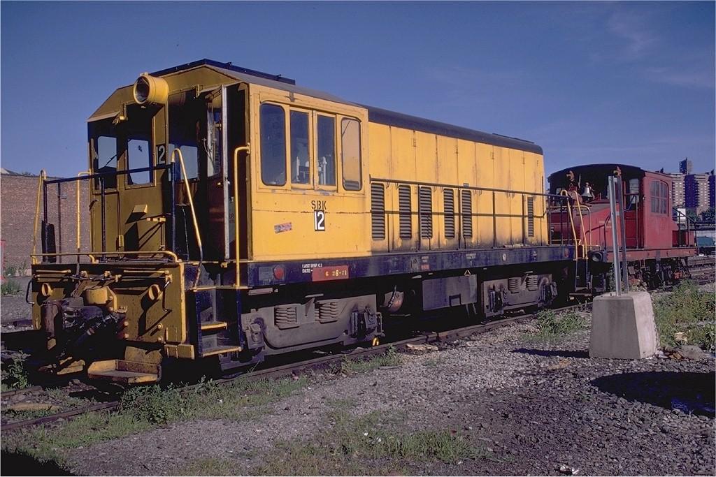 (237k, 1024x683)<br><b>Country:</b> United States<br><b>City:</b> New York<br><b>System:</b> New York City Transit<br><b>Location:</b> Coney Island Yard<br><b>Car:</b> GE 70T Locomotive (SBK)  12 <br><b>Photo by:</b> Doug Grotjahn<br><b>Collection of:</b> Joe Testagrose<br><b>Date:</b> 7/18/1971<br><b>Viewed (this week/total):</b> 0 / 3359