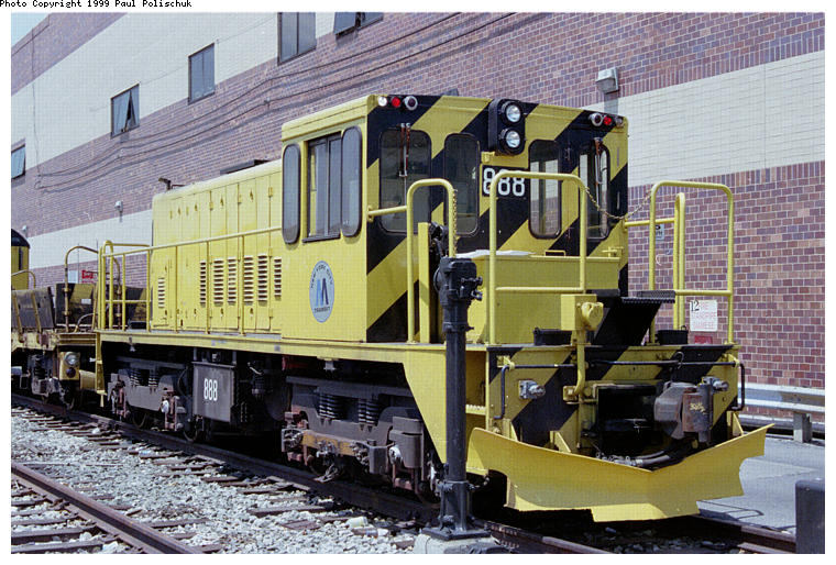 (110k, 760x514)<br><b>Country:</b> United States<br><b>City:</b> New York<br><b>System:</b> New York City Transit<br><b>Location:</b> Corona Yard<br><b>Car:</b> R-77 Locomotive  888 <br><b>Photo by:</b> Paul Polischuk<br><b>Date:</b> 6/25/1999<br><b>Viewed (this week/total):</b> 1 / 2484