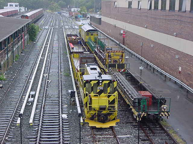 (60k, 640x480)<br><b>Country:</b> United States<br><b>City:</b> New York<br><b>System:</b> New York City Transit<br><b>Location:</b> Corona Yard<br><b>Car:</b> R-77 Locomotive  890 <br><b>Photo by:</b> Salaam Allah<br><b>Date:</b> 9/26/2002<br><b>Viewed (this week/total):</b> 2 / 2900