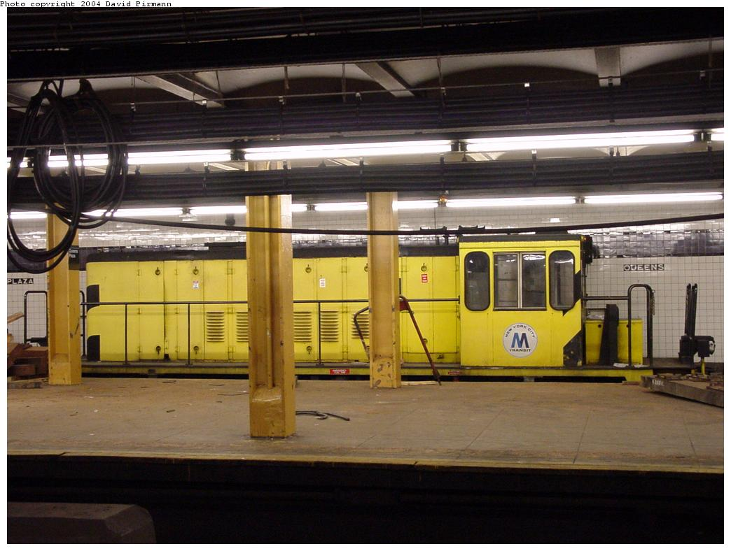 (115k, 1044x788)<br><b>Country:</b> United States<br><b>City:</b> New York<br><b>System:</b> New York City Transit<br><b>Line:</b> IND Queens Boulevard Line<br><b>Location:</b> Queens Plaza <br><b>Car:</b> R-77 Locomotive  891 <br><b>Photo by:</b> David Pirmann<br><b>Date:</b> 1/14/2001<br><b>Viewed (this week/total):</b> 0 / 4561