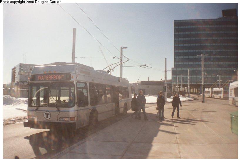 (75k, 820x553)<br><b>Country:</b> United States<br><b>City:</b> Boston, MA<br><b>System:</b> MBTA Boston<br><b>Line:</b> MBTA Silver Line (Phase II)<br><b>Location:</b> Silver Line Way<br><b>Car:</b> MBTA Trolleybus 4113 <br><b>Photo by:</b> Douglas Carrier<br><b>Date:</b> 3/5/2005<br><b>Notes:</b> MBTA 4113 drops people using left door at Silver Line Way.<br><b>Viewed (this week/total):</b> 3 / 3785