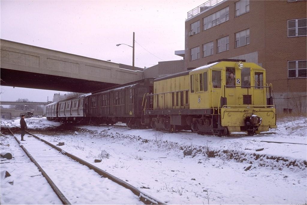 (194k, 1024x686)<br><b>Country:</b> United States<br><b>City:</b> New York<br><b>System:</b> New York City Transit<br><b>Location:</b> LIRR Parkville Jct<br><b>Car:</b> GE 70T Locomotive (SBK)  12 <br><b>Photo by:</b> Steve Zabel<br><b>Collection of:</b> Joe Testagrose<br><b>Date:</b> 2/28/1972<br><b>Viewed (this week/total):</b> 0 / 4333