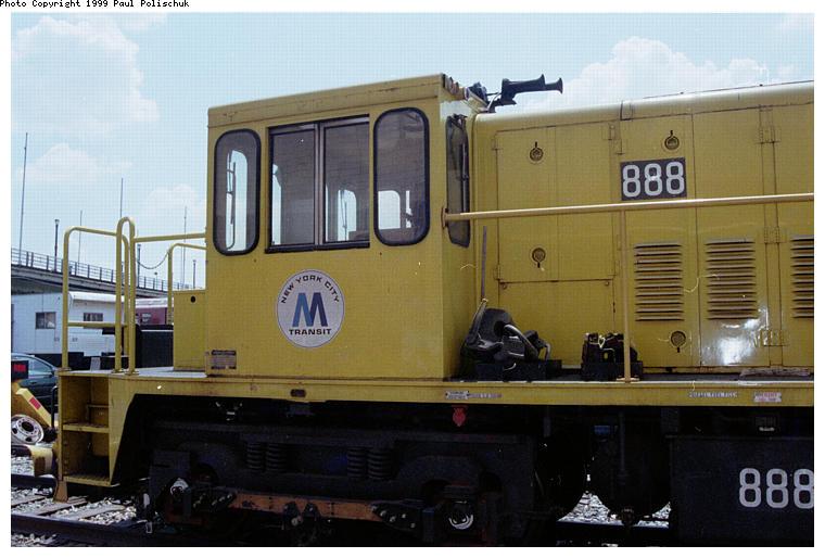 (68k, 760x514)<br><b>Country:</b> United States<br><b>City:</b> New York<br><b>System:</b> New York City Transit<br><b>Location:</b> Corona Yard<br><b>Car:</b> R-77 Locomotive  888 <br><b>Photo by:</b> Paul Polischuk<br><b>Date:</b> 6/25/1999<br><b>Viewed (this week/total):</b> 0 / 2283