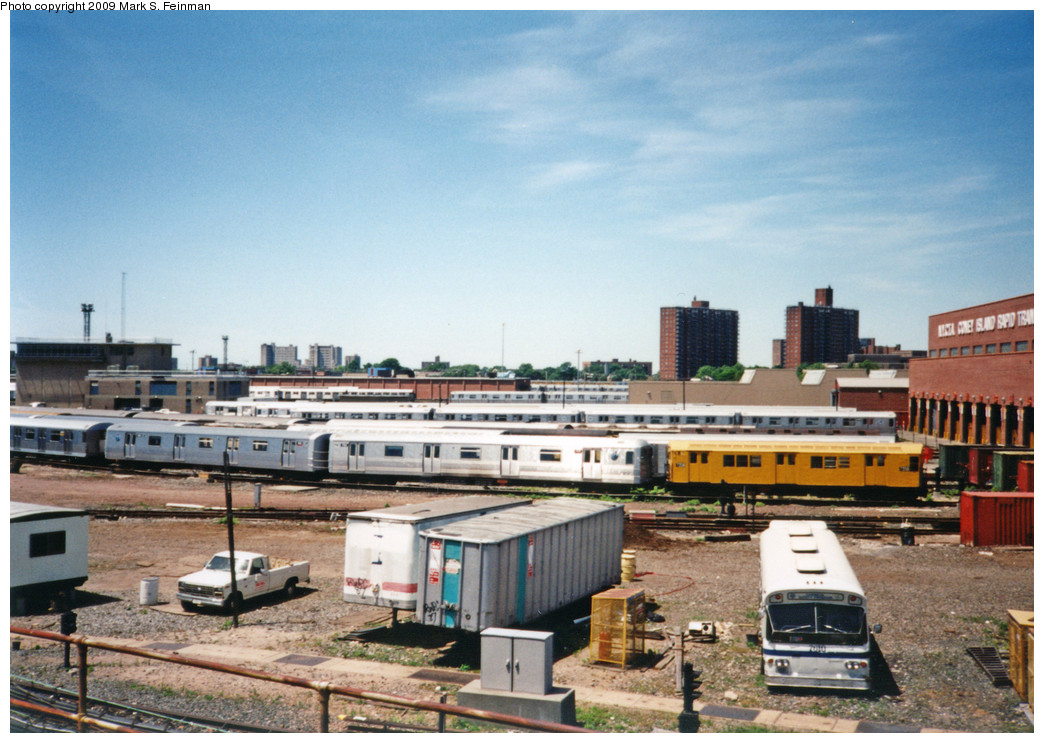 (255k, 1044x743)<br><b>Country:</b> United States<br><b>City:</b> New York<br><b>System:</b> New York City Transit<br><b>Location:</b> Coney Island Yard<br><b>Photo by:</b> Mark S. Feinman<br><b>Date:</b> 5/30/1993<br><b>Notes:</b> View from Avenue X. Visible are an R21 in work service and an old Flxible bus.<br><b>Viewed (this week/total):</b> 0 / 2972