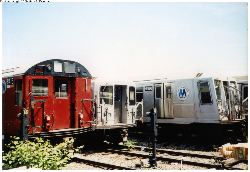 (207k, 1044x720)<br><b>Country:</b> United States<br><b>City:</b> New York<br><b>System:</b> New York City Transit<br><b>Location:</b> Coney Island Yard<br><b>Photo by:</b> Mark S. Feinman<br><b>Date:</b> 5/30/1993<br><b>Notes:</b> On yard loop track. Three models of NYC subway car visible: R30 #8415, R42, R40 #4156<br><b>Viewed (this week/total):</b> 7 / 3448