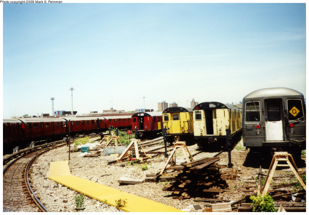 (250k, 1044x729)<br><b>Country:</b> United States<br><b>City:</b> New York<br><b>System:</b> New York City Transit<br><b>Location:</b> Coney Island Yard<br><b>Photo by:</b> Mark S. Feinman<br><b>Date:</b> 5/30/1993<br><b>Notes:</b> Visible are an R30, two R21s, and an R68, and the fan trip train looping thru the yard<br><b>Viewed (this week/total):</b> 0 / 3067