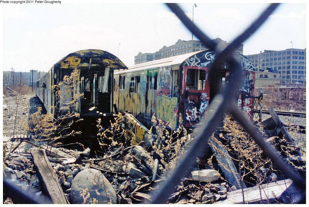 (484k, 1044x701)<br><b>Country:</b> United States<br><b>City:</b> New York<br><b>System:</b> New York City Transit<br><b>Line:</b> South Brooklyn Railway<br><b>Location:</b> SBK Yard (2nd Ave at 38th St.) (SBK)<br><b>Photo by:</b> Peter Dougherty<br><b>Date:</b> 12/1997<br><b>Notes:</b> Bush Terminal scrap yard, Winter 1997<br><b>Viewed (this week/total):</b> 5 / 8930