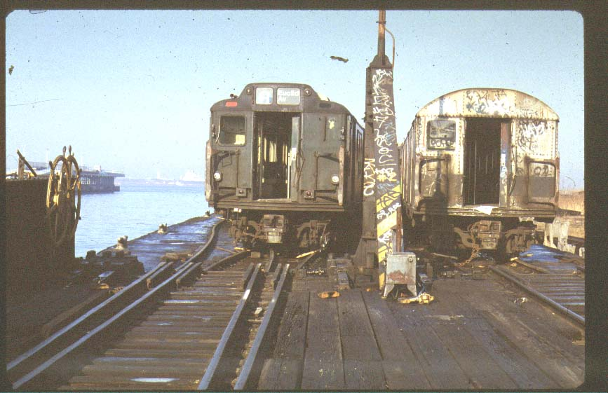 (81k, 867x561)<br><b>Country:</b> United States<br><b>City:</b> New York<br><b>System:</b> New York City Transit<br><b>Location:</b> Scrapyard<br><b>Photo by:</b> Harold<br><b>Notes:</b> R10 and R27/30 at NYCH car float<br><b>Viewed (this week/total):</b> 1 / 8994