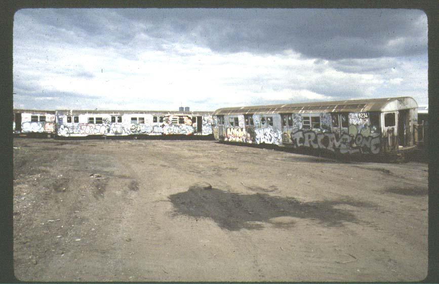(73k, 867x561)<br><b>Country:</b> United States<br><b>City:</b> New York<br><b>System:</b> New York City Transit<br><b>Location:</b> Scrapyard<br><b>Car:</b> R-27 (St. Louis, 1960)  8234 <br><b>Photo by:</b> Harold<br><b>Notes:</b> Naporano scrap yard<br><b>Viewed (this week/total):</b> 4 / 9815
