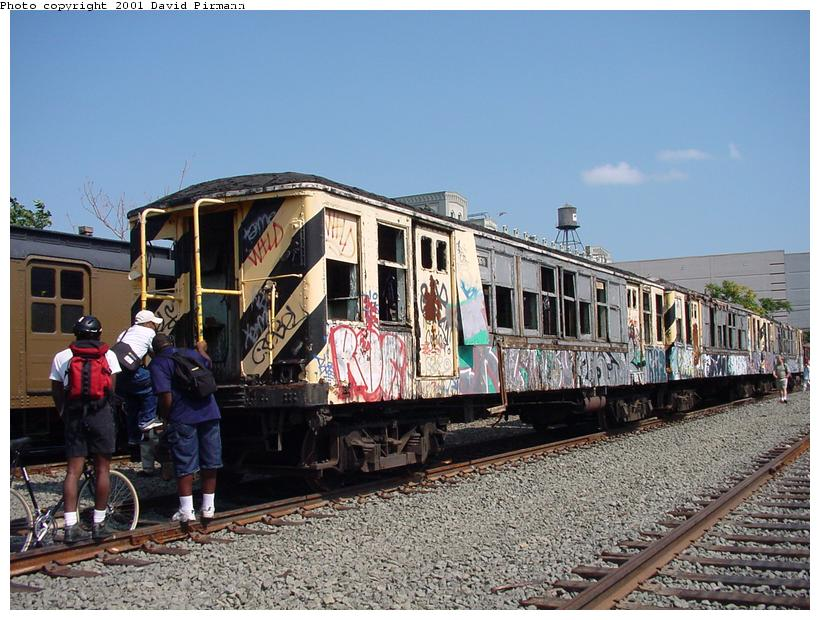(99k, 820x620)<br><b>Country:</b> United States<br><b>City:</b> New York<br><b>System:</b> New York City Transit<br><b>Line:</b> South Brooklyn Railway<br><b>Location:</b> SBK Yard (2nd Ave at 38th St.) (SBK)<br><b>Car:</b> BMT QX  30618 <br><b>Photo by:</b> David Pirmann<br><b>Date:</b> 8/26/2001<br><b>Notes:</b> Q-Type cars in Bush Terminal (SBK) scrap yard.<br><b>Viewed (this week/total):</b> 3 / 7695