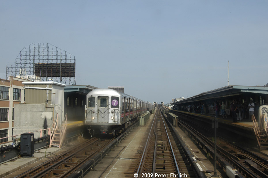 (152k, 930x618)<br><b>Country:</b> United States<br><b>City:</b> New York<br><b>System:</b> New York City Transit<br><b>Line:</b> IRT Flushing Line<br><b>Location:</b> 33rd Street/Rawson Street <br><b>Route:</b> 7<br><b>Car:</b> R-62A (Bombardier, 1984-1987)  1785 <br><b>Photo by:</b> Peter Ehrlich<br><b>Date:</b> 7/22/2009<br><b>Notes:</b> Inbound; another inbound train is visible at 40th Street.<br><b>Viewed (this week/total):</b> 0 / 899