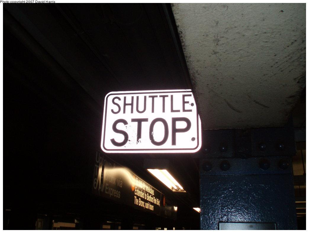 (119k, 1044x788)<br><b>Country:</b> United States<br><b>City:</b> New York<br><b>System:</b> New York City Transit<br><b>Line:</b> IND 6th Avenue Line<br><b>Location:</b> Grand Street <br><b>Photo by:</b> David Harris<br><b>Date:</b> 7/27/2007<br><b>Notes:</b> Shuttle stop sign at Grand St. (former shuttle during Manhattan Br. construction).<br><b>Viewed (this week/total):</b> 0 / 3581