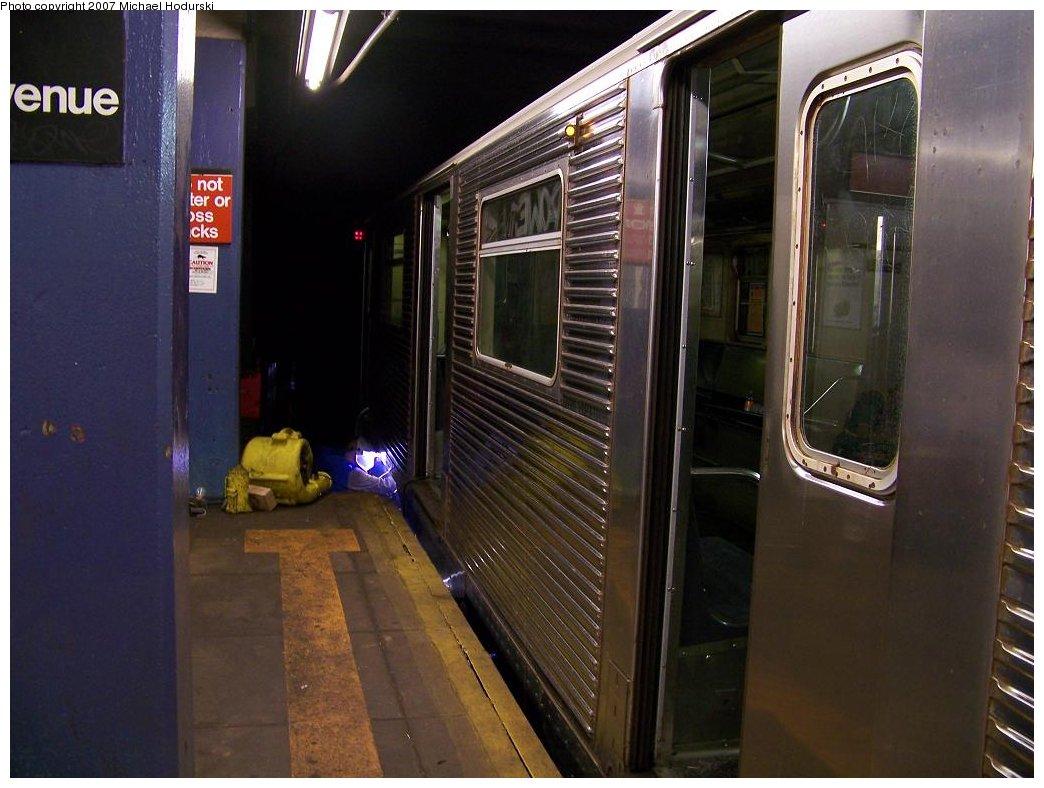 (159k, 1044x788)<br><b>Country:</b> United States<br><b>City:</b> New York<br><b>System:</b> New York City Transit<br><b>Line:</b> IND Queens Boulevard Line<br><b>Location:</b> 7th Avenue/53rd Street <br><b>Route:</b> E<br><b>Car:</b> R-32 (Budd, 1964)  3754 <br><b>Photo by:</b> Michael Hodurski<br><b>Date:</b> 7/27/2007<br><b>Notes:</b> Emergency wheel repair being performed.<br><b>Viewed (this week/total):</b> 1 / 3676