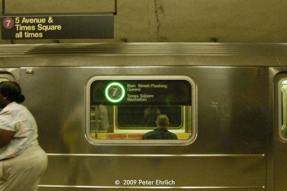 (171k, 930x618)<br><b>Country:</b> United States<br><b>City:</b> New York<br><b>System:</b> New York City Transit<br><b>Line:</b> IRT Flushing Line<br><b>Route:</b> 7<br><b>Car:</b> R-62A (Bombardier, 1984-1987)  1993 <br><b>Photo by:</b> Peter Ehrlich<br><b>Date:</b> 7/22/2009<br><b>Notes:</b> Illuminated green circle denotes a local train.<br><b>Viewed (this week/total):</b> 0 / 903
