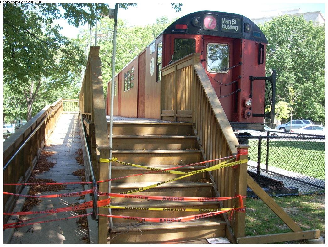 (299k, 1044x788)<br><b>Country:</b> United States<br><b>City:</b> New York<br><b>System:</b> New York City Transit<br><b>Location:</b> Queens Borough Hall<br><b>Car:</b> R-33 Main Line (St. Louis, 1962-63) 9075 <br><b>Photo by:</b> Bill E.<br><b>Date:</b> 8/11/2007<br><b>Notes:</b> Display redbird with damaged doors.<br><b>Viewed (this week/total):</b> 0 / 2876