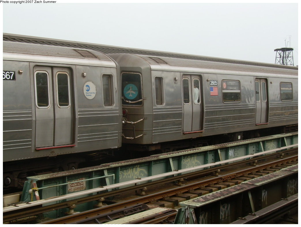 (188k, 1044x788)<br><b>Country:</b> United States<br><b>City:</b> New York<br><b>System:</b> New York City Transit<br><b>Line:</b> BMT West End Line<br><b>Location:</b> Fort Hamilton Parkway <br><b>Route:</b> D<br><b>Car:</b> R-68 (Westinghouse-Amrail, 1986-1988)  2665 <br><b>Photo by:</b> Zach Summer<br><b>Date:</b> 8/7/2007<br><b>Notes:</b> Note JFK Train to the Plane rollsign between cars.<br><b>Viewed (this week/total):</b> 2 / 2789
