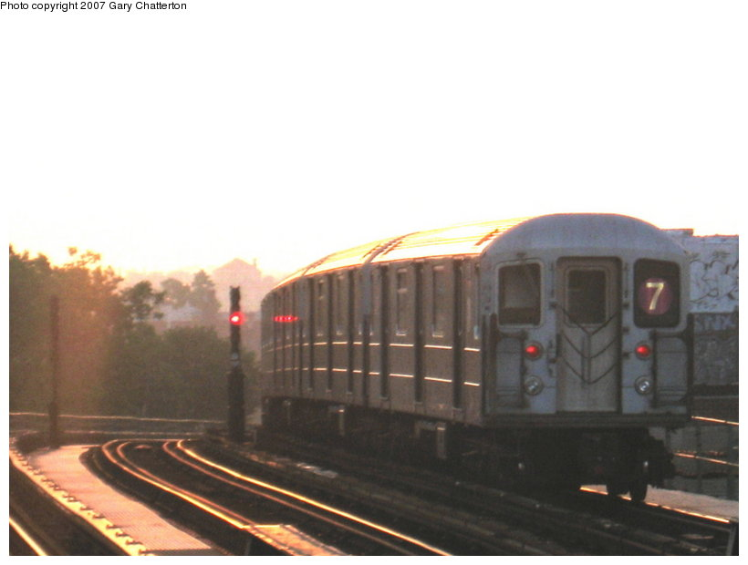 (65k, 820x620)<br><b>Country:</b> United States<br><b>City:</b> New York<br><b>System:</b> New York City Transit<br><b>Line:</b> IRT Flushing Line<br><b>Location:</b> 52nd Street/Lincoln Avenue<br><b>Route:</b> 7<br><b>Car:</b> R-62A (Bombardier, 1984-1987) 1705 <br><b>Photo by:</b> Gary Chatterton<br><b>Date:</b> 8/7/2007<br><b>Notes:</b> Sunrise<br><b>Viewed (this week/total):</b> 0 / 1554