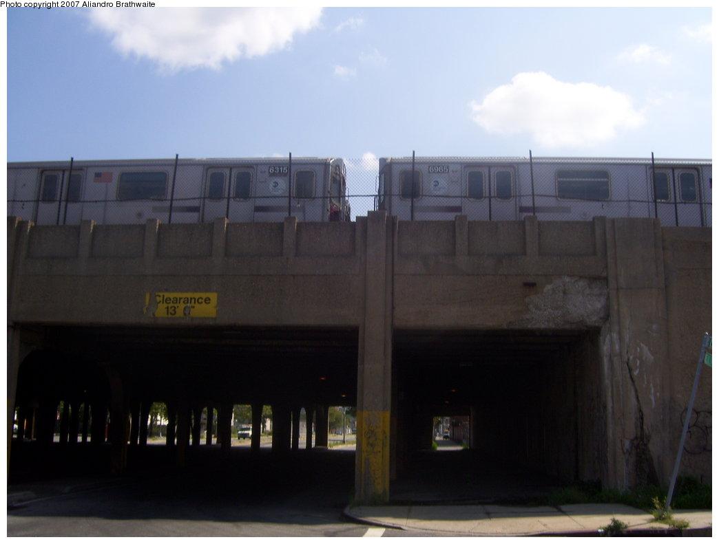 (105k, 1044x791)<br><b>Country:</b> United States<br><b>City:</b> New York<br><b>System:</b> New York City Transit<br><b>Location:</b> Livonia Yard<br><b>Car:</b> R-142 (Primary Order, Bombardier, 1999-2002)  6965/6315 <br><b>Photo by:</b> Aliandro Brathwaite<br><b>Date:</b> 8/9/2007<br><b>Viewed (this week/total):</b> 3 / 4824