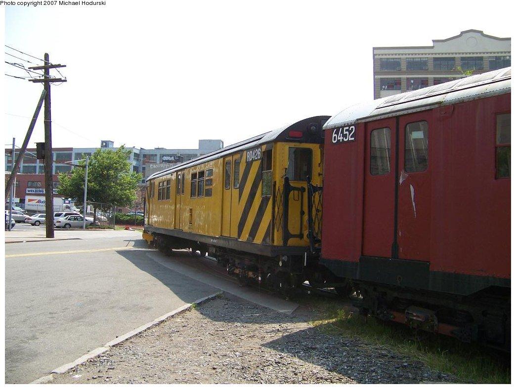 (171k, 1044x788)<br><b>Country:</b> United States<br><b>City:</b> New York<br><b>System:</b> New York City Transit<br><b>Line:</b> South Brooklyn Railway<br><b>Location:</b> 2nd Avenue (SBK)<br><b>Car:</b> R-161 Rider Car (ex-R-33)  RD426 (ex-9071)<br><b>Photo by:</b> Michael Hodurski<br><b>Date:</b> 7/17/2007<br><b>Notes:</b> Being used as spacer car between scrap cars and locomotive.<br><b>Viewed (this week/total):</b> 2 / 1773