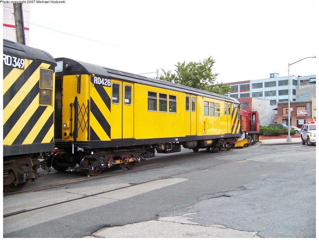 (192k, 1044x788)<br><b>Country:</b> United States<br><b>City:</b> New York<br><b>System:</b> New York City Transit<br><b>Line:</b> South Brooklyn Railway<br><b>Location:</b> 2nd Avenue (SBK)<br><b>Car:</b> R-161 Rider Car (ex-R-33)  RD426 (ex-9071)<br><b>Photo by:</b> Michael Hodurski<br><b>Date:</b> 7/19/2007<br><b>Notes:</b> Being used as spacer car between scrap cars and locomotive.<br><b>Viewed (this week/total):</b> 0 / 1605