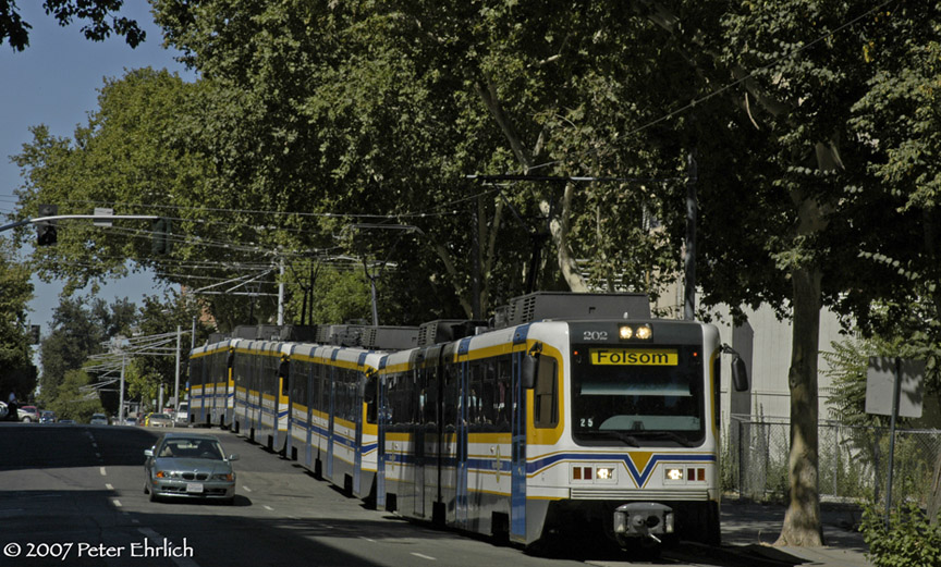 (227k, 864x521)<br><b>Country:</b> United States<br><b>City:</b> Sacramento, CA<br><b>System:</b> SACRT Light Rail<br><b>Location:</b> 8th & L <br><b>Car:</b> Sacramento CAF LRV  202 <br><b>Photo by:</b> Peter Ehrlich<br><b>Date:</b> 8/20/2007<br><b>Notes:</b> 4-car Folsom Line train at 8th Street/L Street outbound, approaching 8th & Capitol Station.<br><b>Viewed (this week/total):</b> 1 / 1376
