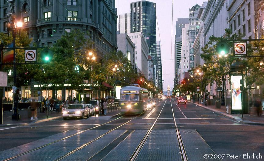 (231k, 864x528)<br><b>Country:</b> United States<br><b>City:</b> San Francisco/Bay Area, CA<br><b>System:</b> SF MUNI<br><b>Location:</b> Market/5th <br><b>Car:</b> SF MUNI PCC (Ex-SEPTA) (St. Louis Car Co., 1947-1948)  1055 <br><b>Photo by:</b> Peter Ehrlich<br><b>Date:</b> 6/27/1996<br><b>Notes:</b> Market/5th Street outbound, twilight view.<br><b>Viewed (this week/total):</b> 0 / 724
