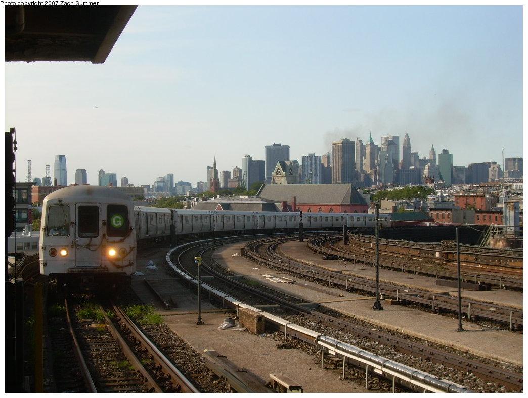 (199k, 1044x788)<br><b>Country:</b> United States<br><b>City:</b> New York<br><b>System:</b> New York City Transit<br><b>Line:</b> IND Crosstown Line<br><b>Location:</b> Smith/9th Street <br><b>Route:</b> G<br><b>Car:</b> R-46 (Pullman-Standard, 1974-75)  <br><b>Photo by:</b> Zach Summer<br><b>Date:</b> 8/18/2007<br><b>Notes:</b> Smoke in background from Deutsche Bank tower fire.<br><b>Viewed (this week/total):</b> 0 / 2615