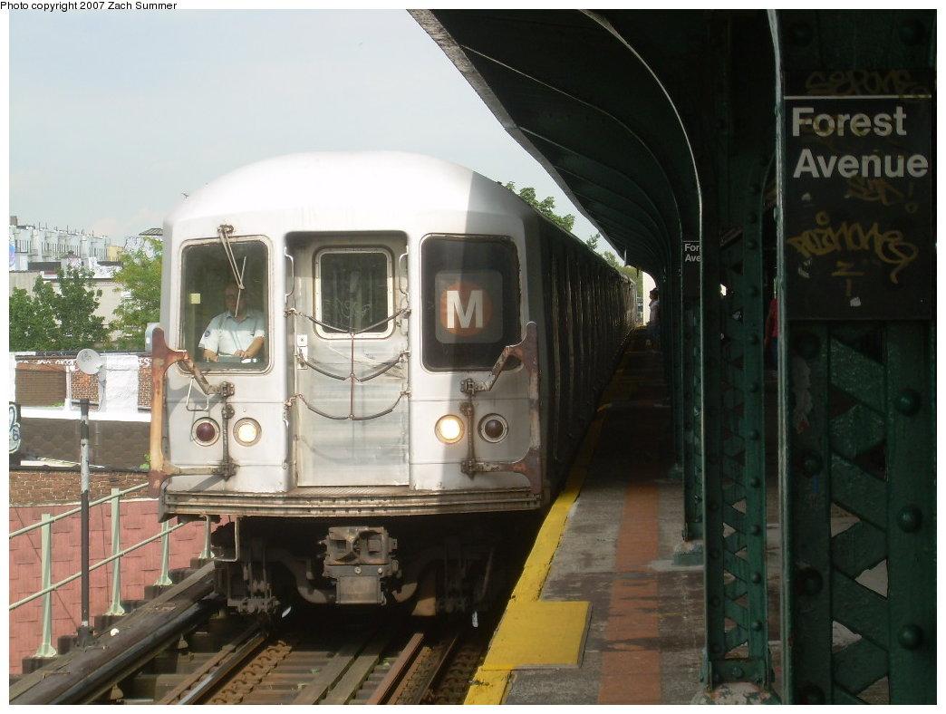 (185k, 1044x788)<br><b>Country:</b> United States<br><b>City:</b> New York<br><b>System:</b> New York City Transit<br><b>Line:</b> BMT Myrtle Avenue Line<br><b>Location:</b> Forest Avenue <br><b>Route:</b> M<br><b>Car:</b> R-42 (St. Louis, 1969-1970)  4904 <br><b>Photo by:</b> Zach Summer<br><b>Date:</b> 8/28/2007<br><b>Viewed (this week/total):</b> 1 / 2058