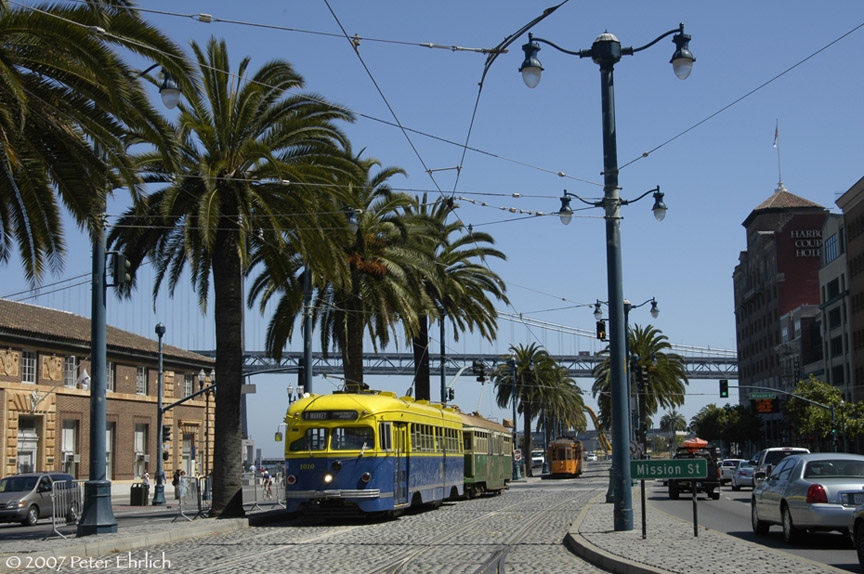 (217k, 864x574)<br><b>Country:</b> United States<br><b>City:</b> San Francisco/Bay Area, CA<br><b>System:</b> SF MUNI<br><b>Location:</b> Embarcadero/Ferry Plaza Layover <br><b>Car:</b> SF MUNI PCC Torpedo Double-End (St. Louis Car Co., 1948)  1010 <br><b>Photo by:</b> Peter Ehrlich<br><b>Date:</b> 8/22/2007<br><b>Notes:</b> Ferries layover.  With 496 (Melbourne), and 1859 (Milan) across Mission Street.<br><b>Viewed (this week/total):</b> 0 / 531