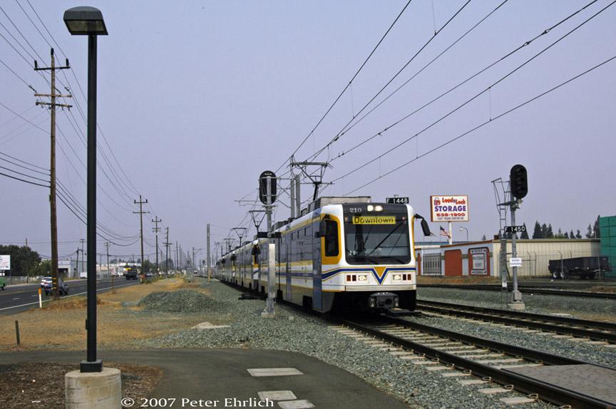 (178k, 864x574)<br><b>Country:</b> United States<br><b>City:</b> Sacramento, CA<br><b>System:</b> SACRT Light Rail<br><b>Location:</b> Sunrise <br><b>Car:</b> Sacramento CAF LRV  210 <br><b>Photo by:</b> Peter Ehrlich<br><b>Date:</b> 9/5/2007<br><b>Notes:</b> Approaching Sunrise Statinn inbound.  Note car in layover track in background.<br><b>Viewed (this week/total):</b> 0 / 804
