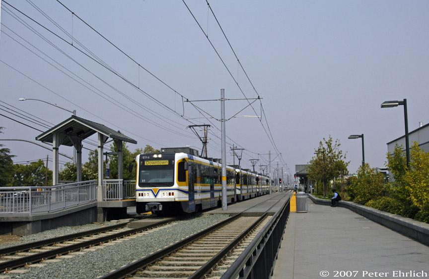 (170k, 864x563)<br><b>Country:</b> United States<br><b>City:</b> Sacramento, CA<br><b>System:</b> SACRT Light Rail<br><b>Location:</b> Sunrise <br><b>Car:</b> Sacramento CAF LRV  234 <br><b>Photo by:</b> Peter Ehrlich<br><b>Date:</b> 9/5/2007<br><b>Notes:</b> Four-car train now ready to continue inbound.<br><b>Viewed (this week/total):</b> 0 / 917
