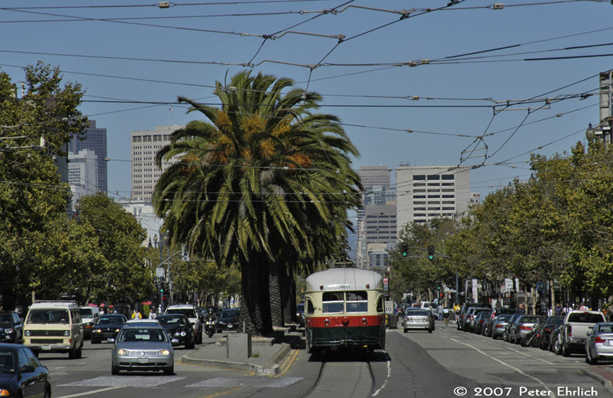 (216k, 864x561)<br><b>Country:</b> United States<br><b>City:</b> San Francisco/Bay Area, CA<br><b>System:</b> SF MUNI<br><b>Location:</b> Market/17th/Castro <br><b>Car:</b> SF MUNI PCC (Ex-NJTransit, Ex-Twin City) (St. Louis Car Co., 1946-1947)  1077 <br><b>Photo by:</b> Peter Ehrlich<br><b>Date:</b> 9/1/2007<br><b>Notes:</b> Market/Castro inbound, rear view.<br><b>Viewed (this week/total):</b> 0 / 482