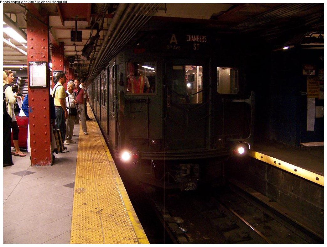 (173k, 1044x788)<br><b>Country:</b> United States<br><b>City:</b> New York<br><b>System:</b> New York City Transit<br><b>Line:</b> IND 8th Avenue Line<br><b>Location:</b> 59th Street/Columbus Circle <br><b>Route:</b> Fan Trip<br><b>Car:</b> R-1 (American Car & Foundry, 1930-1931) 100 <br><b>Photo by:</b> Michael Hodurski<br><b>Date:</b> 9/12/2007<br><b>Notes:</b> Car move from 207th to Transit Museum<br><b>Viewed (this week/total):</b> 1 / 2493