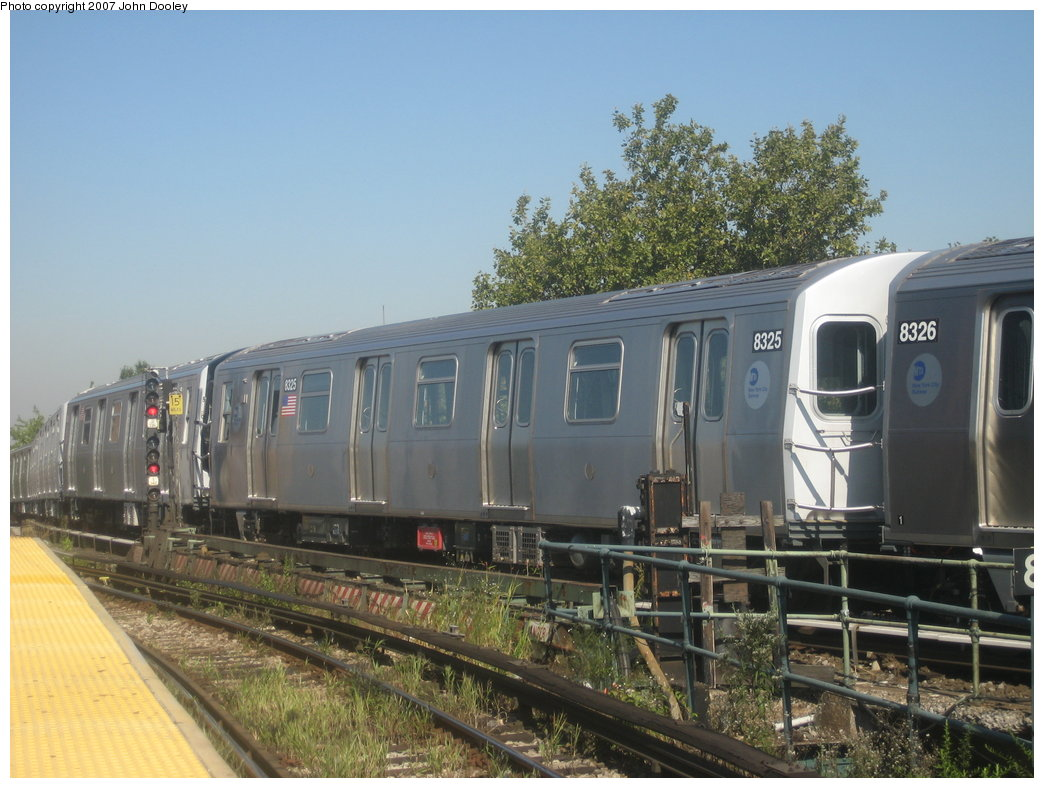 (173k, 1044x788)<br><b>Country:</b> United States<br><b>City:</b> New York<br><b>System:</b> New York City Transit<br><b>Line:</b> BMT Nassau Street/Jamaica Line<br><b>Location:</b> Broadway/East New York (Broadway Junction) <br><b>Route:</b> Z<br><b>Car:</b> R-160A-1 (Alstom, 2005-2008, 4 car sets)  8325 <br><b>Photo by:</b> John Dooley<br><b>Date:</b> 9/20/2007<br><b>Viewed (this week/total):</b> 1 / 2174