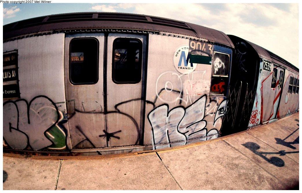 (168k, 1044x669)<br><b>Country:</b> United States<br><b>City:</b> New York<br><b>System:</b> New York City Transit<br><b>Line:</b> IRT White Plains Road Line<br><b>Location:</b> West Farms Sq./East Tremont Ave./177th St. <br><b>Car:</b> R-33 Main Line (St. Louis, 1962-63) 9043 <br><b>Photo by:</b> Mel Wilner<br><b>Notes:</b> Circa 1979.<br><b>Viewed (this week/total):</b> 2 / 2740