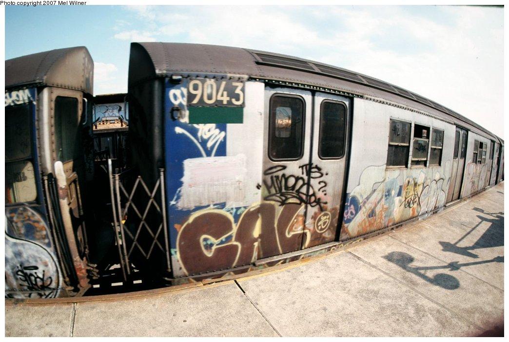 (153k, 1044x701)<br><b>Country:</b> United States<br><b>City:</b> New York<br><b>System:</b> New York City Transit<br><b>Line:</b> IRT White Plains Road Line<br><b>Location:</b> West Farms Sq./East Tremont Ave./177th St. <br><b>Car:</b> R-33 Main Line (St. Louis, 1962-63) 9043 <br><b>Photo by:</b> Mel Wilner<br><b>Notes:</b> Circa 1979.<br><b>Viewed (this week/total):</b> 0 / 2722