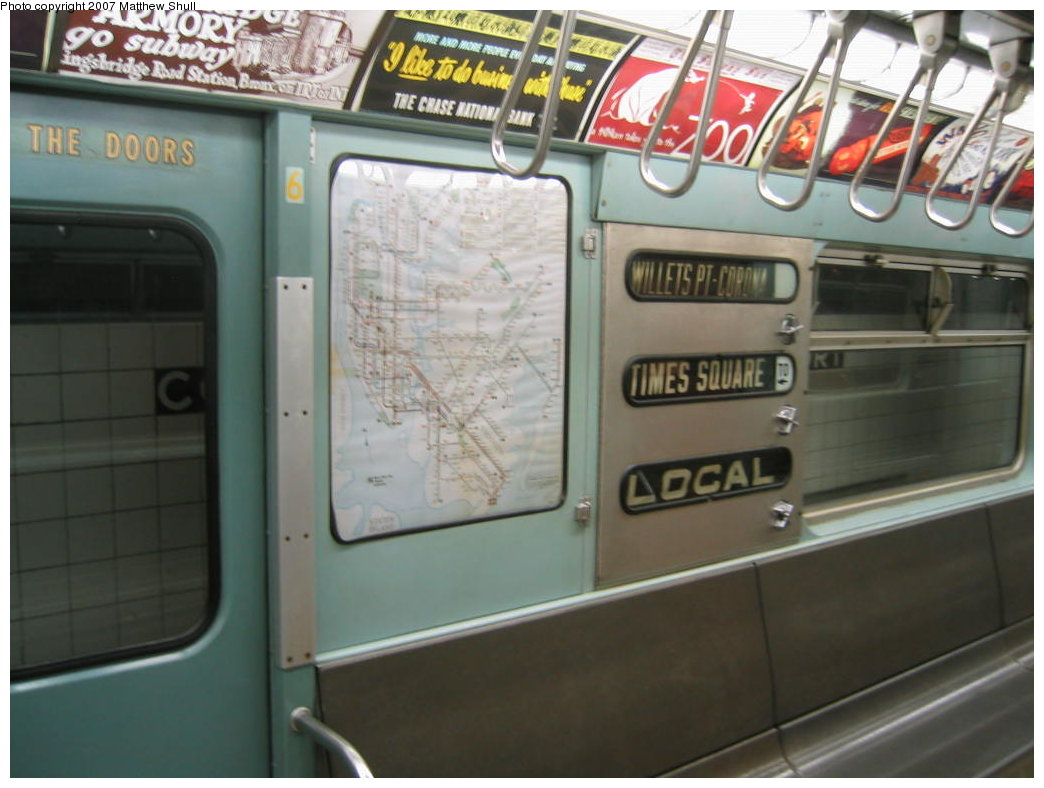 (143k, 1044x788)<br><b>Country:</b> United States<br><b>City:</b> New York<br><b>System:</b> New York City Transit<br><b>Location:</b> New York Transit Museum<br><b>Car:</b> R-33 World's Fair (St. Louis, 1963-64) 9306 <br><b>Photo by:</b> Matthew Shull<br><b>Date:</b> 8/31/2007<br><b>Notes:</b> Interior Rollsigns - Properly set for 7 route to Willets Point<br><b>Viewed (this week/total):</b> 0 / 2290