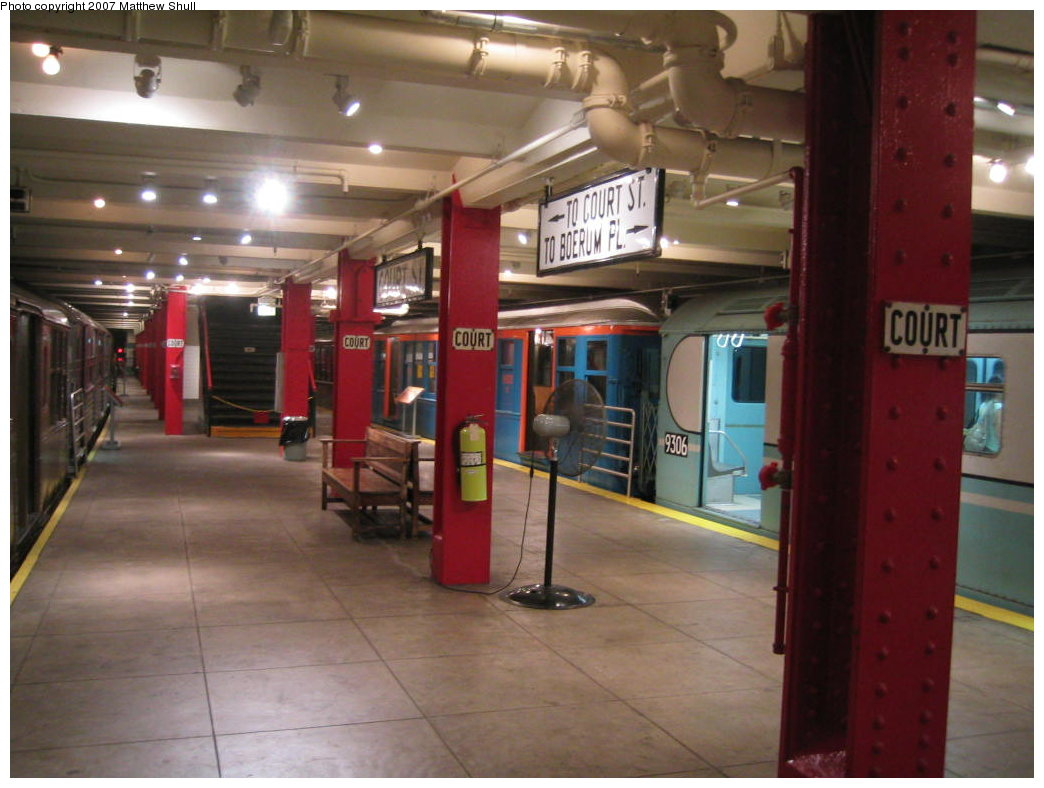 (151k, 1044x788)<br><b>Country:</b> United States<br><b>City:</b> New York<br><b>System:</b> New York City Transit<br><b>Location:</b> New York Transit Museum<br><b>Photo by:</b> Matthew Shull<br><b>Date:</b> 8/31/2007<br><b>Notes:</b> Platform View of World's Fair Cars - BMT Q 1612 & R33 WF 9306 - Also Closed Exit to Court St<br><b>Viewed (this week/total):</b> 0 / 3353
