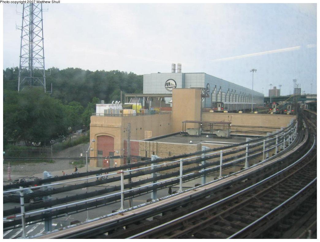 (146k, 1044x788)<br><b>Country:</b> United States<br><b>City:</b> New York<br><b>System:</b> New York City Transit<br><b>Location:</b> East 180th Street Yard<br><b>Route:</b> <5><br><b>Car:</b> R-142 (Option Order, Bombardier, 2002-2003)  7002 <br><b>Photo by:</b> Matthew Shull<br><b>Date:</b> 8/31/2007<br><b>Notes:</b> View of East 180th St. Shops through window of <5> train<br><b>Viewed (this week/total):</b> 0 / 3280