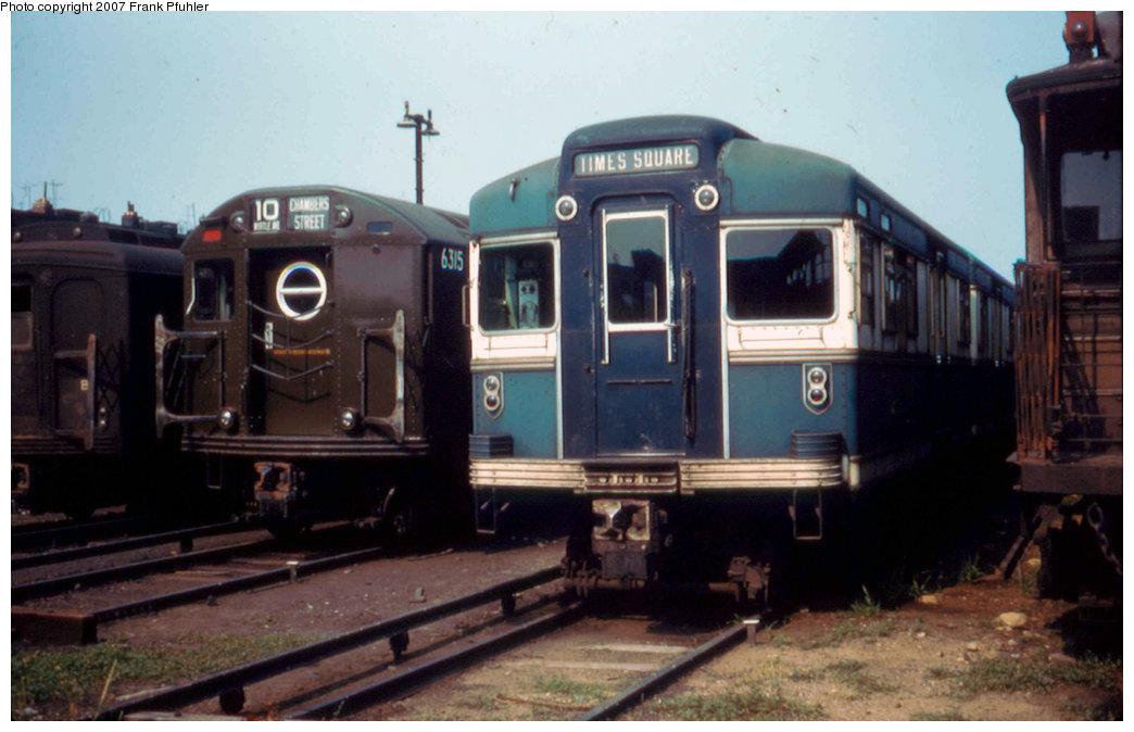 (172k, 1044x674)<br><b>Country:</b> United States<br><b>City:</b> New York<br><b>System:</b> New York City Transit<br><b>Location:</b> Fresh Pond Yard<br><b>Car:</b> BMT Bluebird 8004 <br><b>Photo by:</b> Frank Pfuhler<br><b>Date:</b> 7/4/1955<br><b>Viewed (this week/total):</b> 0 / 2698