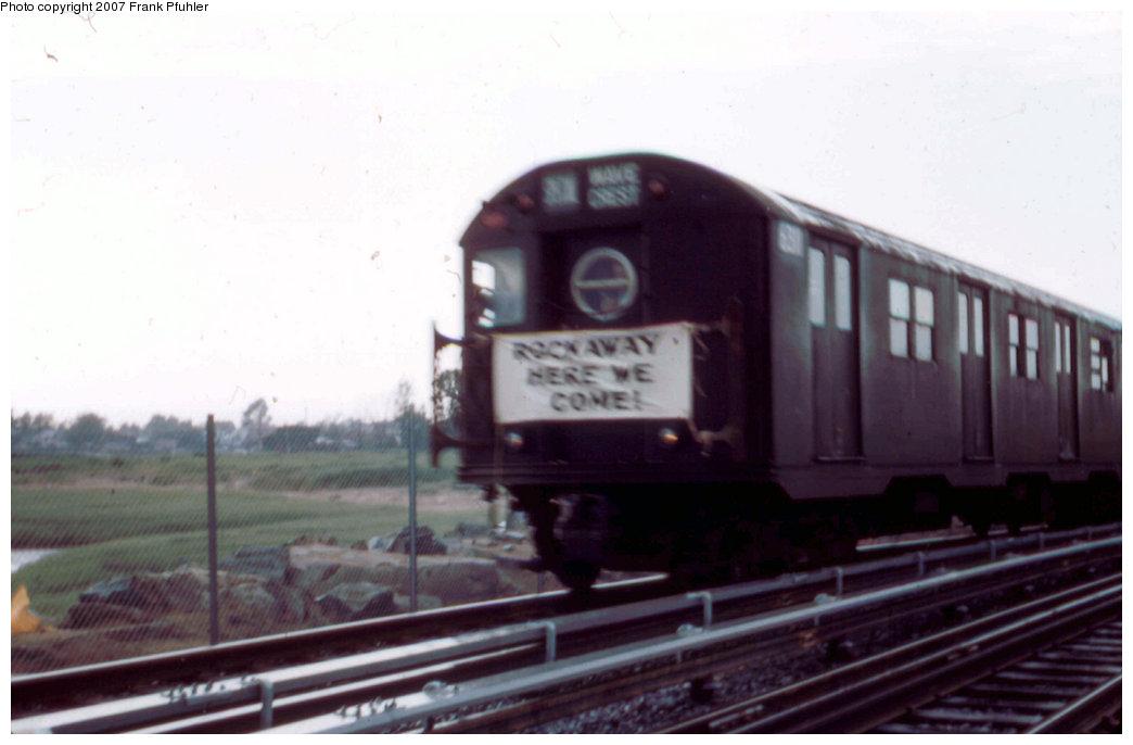 (132k, 1044x686)<br><b>Country:</b> United States<br><b>City:</b> New York<br><b>System:</b> New York City Transit<br><b>Line:</b> IND Rockaway<br><b>Location:</b> Howard Beach <br><b>Car:</b> R-16 (American Car & Foundry, 1955) 6311 <br><b>Photo by:</b> Frank Pfuhler<br><b>Date:</b> 6/28/1956<br><b>Notes:</b> First subway train to the Rockaways. South of Howard Beach near Hamilton Beach/164th Ave.<br><b>Viewed (this week/total):</b> 2 / 7225