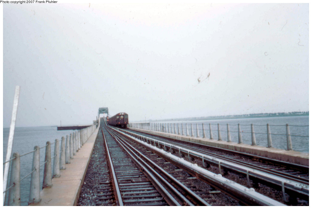 (145k, 1044x701)<br><b>Country:</b> United States<br><b>City:</b> New York<br><b>System:</b> New York City Transit<br><b>Line:</b> IND Rockaway<br><b>Location:</b> North Channel Bridge <br><b>Car:</b> R-16 (American Car & Foundry, 1955)  <br><b>Photo by:</b> Frank Pfuhler<br><b>Date:</b> 6/26/1956<br><b>Notes:</b> First subway train to the Rockaways.<br><b>Viewed (this week/total):</b> 3 / 3397