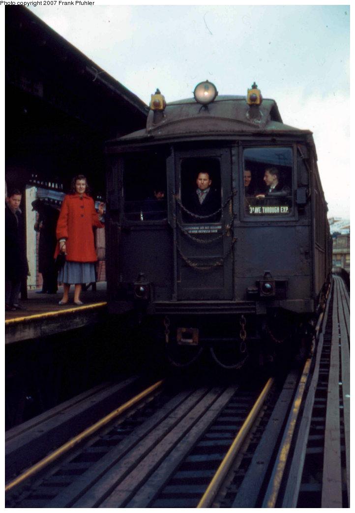 (143k, 722x1044)<br><b>Country:</b> United States<br><b>City:</b> New York<br><b>System:</b> New York City Transit<br><b>Line:</b> 3rd Avenue El<br><b>Location:</b> Chatham Square <br><b>Route:</b> Fan Trip<br><b>Car:</b> MUDC  <br><b>Photo by:</b> Frank Pfuhler<br><b>Date:</b> 3/27/1955<br><b>Notes:</b> View north towards rear MUDC Car of uptown local train.<br><b>Viewed (this week/total):</b> 8 / 2735