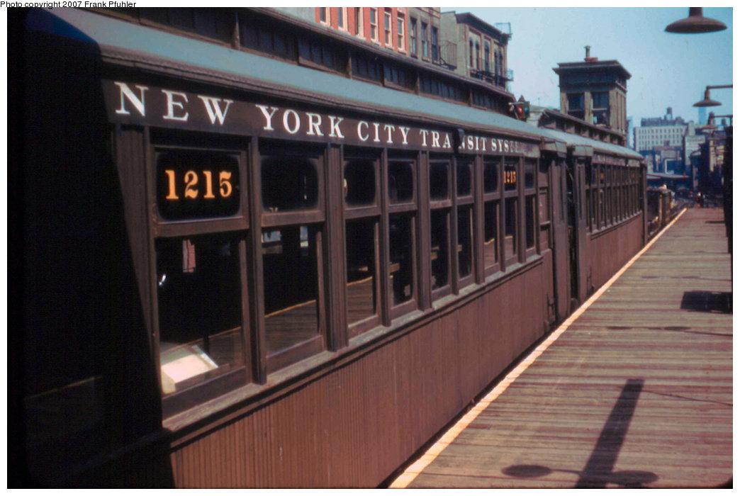 (183k, 1044x700)<br><b>Country:</b> United States<br><b>City:</b> New York<br><b>System:</b> New York City Transit<br><b>Line:</b> 3rd Avenue El<br><b>Location:</b> Canal Street <br><b>Car:</b> MUDC 1215/1306 <br><b>Photo by:</b> Frank Pfuhler<br><b>Date:</b> 5/10/1955<br><b>Notes:</b> Work train.<br><b>Viewed (this week/total):</b> 1 / 3185