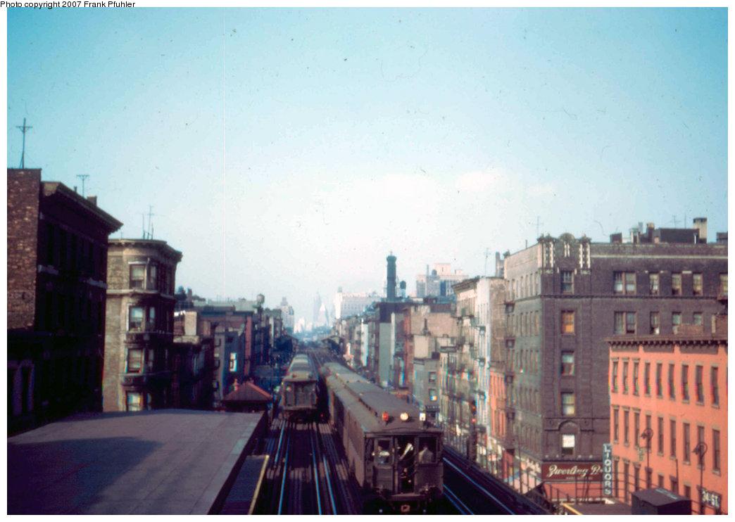 (171k, 1044x742)<br><b>Country:</b> United States<br><b>City:</b> New York<br><b>System:</b> New York City Transit<br><b>Line:</b> 3rd Avenue El<br><b>Location:</b> 34th Street <br><b>Car:</b> MUDC  <br><b>Photo by:</b> Frank Pfuhler<br><b>Date:</b> 6/3/1954<br><b>Notes:</b> Morning view south with dead-heading uptown Q-Type train at left; downtown MUDC express on center track<br><b>Viewed (this week/total):</b> 3 / 2939
