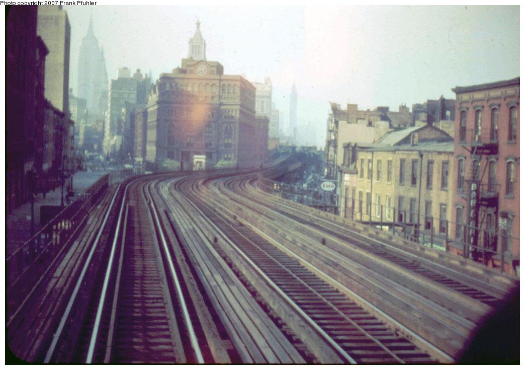 (196k, 1044x735)<br><b>Country:</b> United States<br><b>City:</b> New York<br><b>System:</b> New York City Transit<br><b>Line:</b> 3rd Avenue El<br><b>Location:</b> Cooper Square <br><b>Car:</b> MUDC  <br><b>Photo by:</b> Frank Pfuhler<br><b>Date:</b> 5/12/1955<br><b>Notes:</b> South of station, view looking north at Cooper Union.<br><b>Viewed (this week/total):</b> 2 / 3612