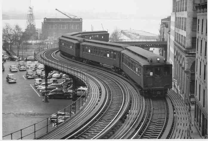 (33k, 696x473)<br><b>Country:</b> United States<br><b>City:</b> New York<br><b>System:</b> New York City Transit<br><b>Line:</b> 3rd Avenue El<br><b>Location:</b> Coenties Slip Curve <br><b>Car:</b> MUDC  <br><b>Collection of:</b> Frank Pfuhler<br><b>Viewed (this week/total):</b> 1 / 7974