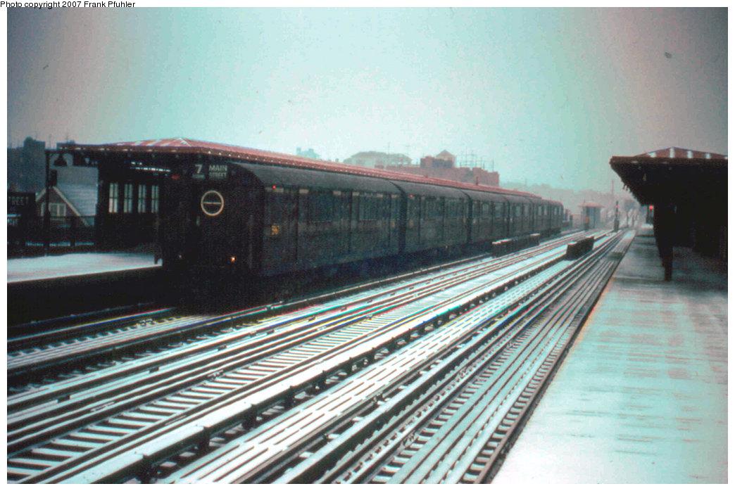 (226k, 1044x698)<br><b>Country:</b> United States<br><b>City:</b> New York<br><b>System:</b> New York City Transit<br><b>Line:</b> IRT Flushing Line<br><b>Location:</b> 69th Street/Fisk Avenue <br><b>Route:</b> 7<br><b>Car:</b> R-15 (American Car & Foundry, 1950) 5767 <br><b>Photo by:</b> Frank Pfuhler<br><b>Date:</b> 3/24/1956<br><b>Viewed (this week/total):</b> 2 / 3158