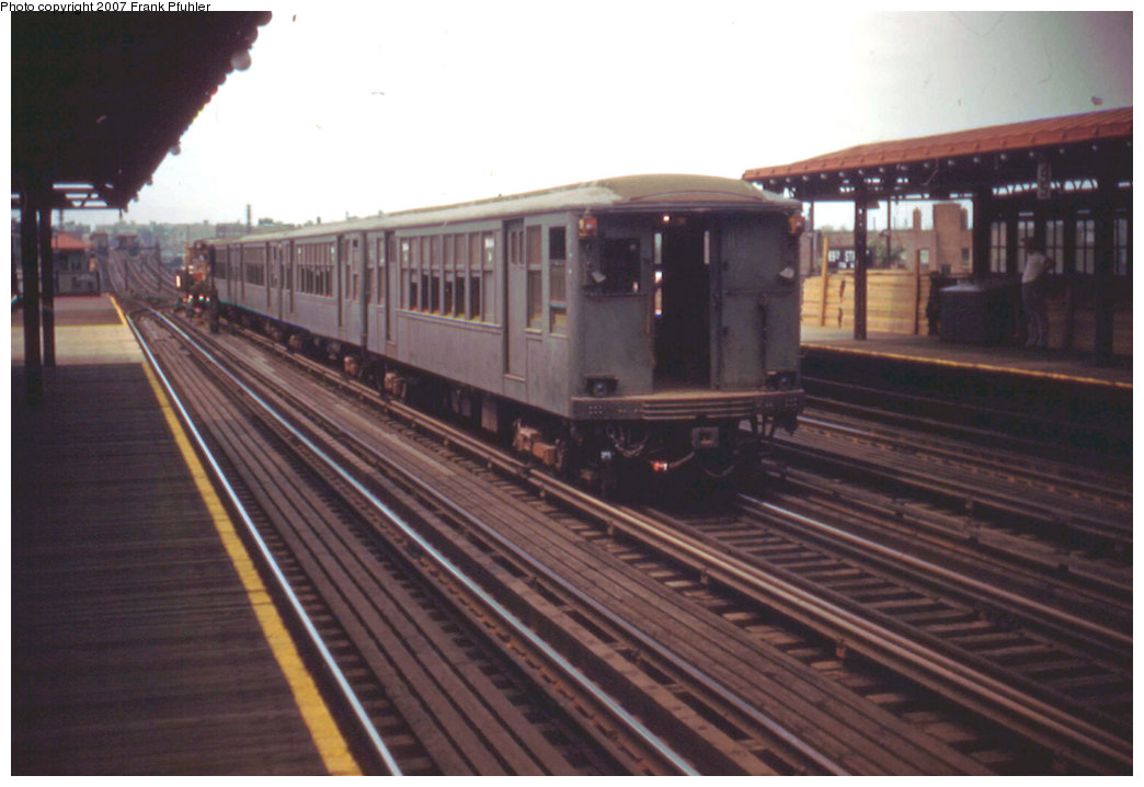 (176k, 1044x718)<br><b>Country:</b> United States<br><b>City:</b> New York<br><b>System:</b> New York City Transit<br><b>Line:</b> IRT Flushing Line<br><b>Location:</b> 69th Street/Fisk Avenue <br><b>Route:</b> Work Service<br><b>Car:</b> BMT Q  <br><b>Photo by:</b> Frank Pfuhler<br><b>Date:</b> 8/7/1955<br><b>Viewed (this week/total):</b> 2 / 2514