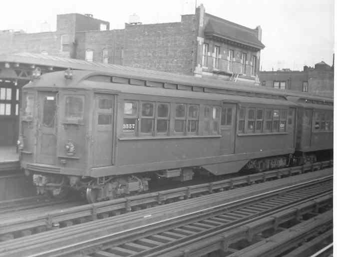 (21k, 675x515)<br><b>Country:</b> United States<br><b>City:</b> New York<br><b>System:</b> New York City Transit<br><b>Line:</b> IRT Pelham Line<br><b>Location:</b> Elder Avenue <br><b>Car:</b> Hi-V 3557 <br><b>Photo by:</b> Frank Pfuhler<br><b>Date:</b> 1/31/1954<br><b>Notes:</b> Hi-V Gibbs MUDC car with replacement new end storm doors and MUDC vestibule doors.<br><b>Viewed (this week/total):</b> 1 / 2426